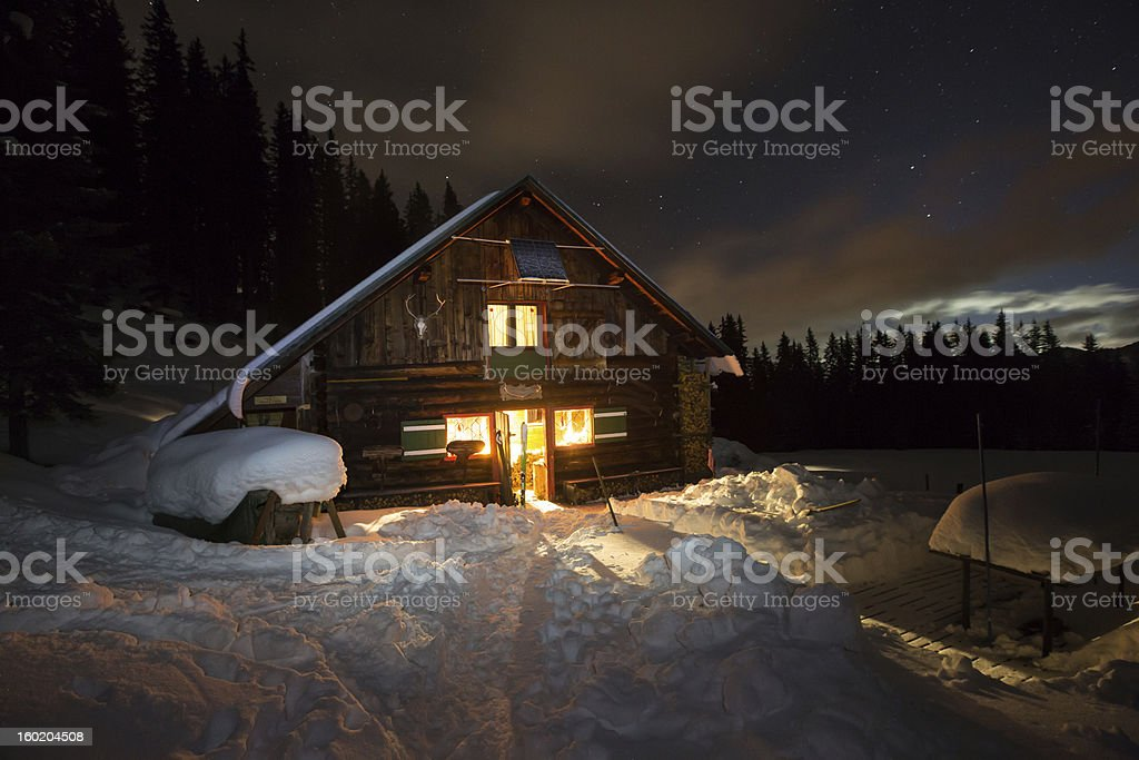 Lightened mountain hut in the austrian alps royalty-free stock photo