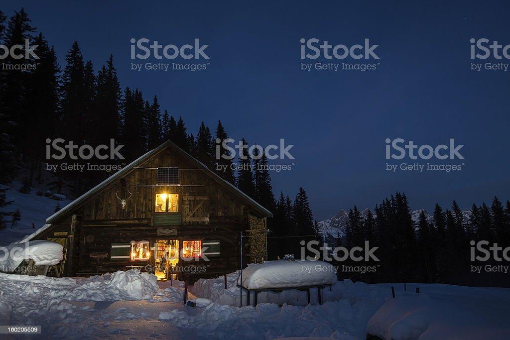 Lightened mountain hut in the austrian alps stock photo