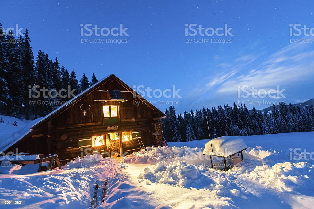 Lightened mountain hut in the austrian alps stock photo