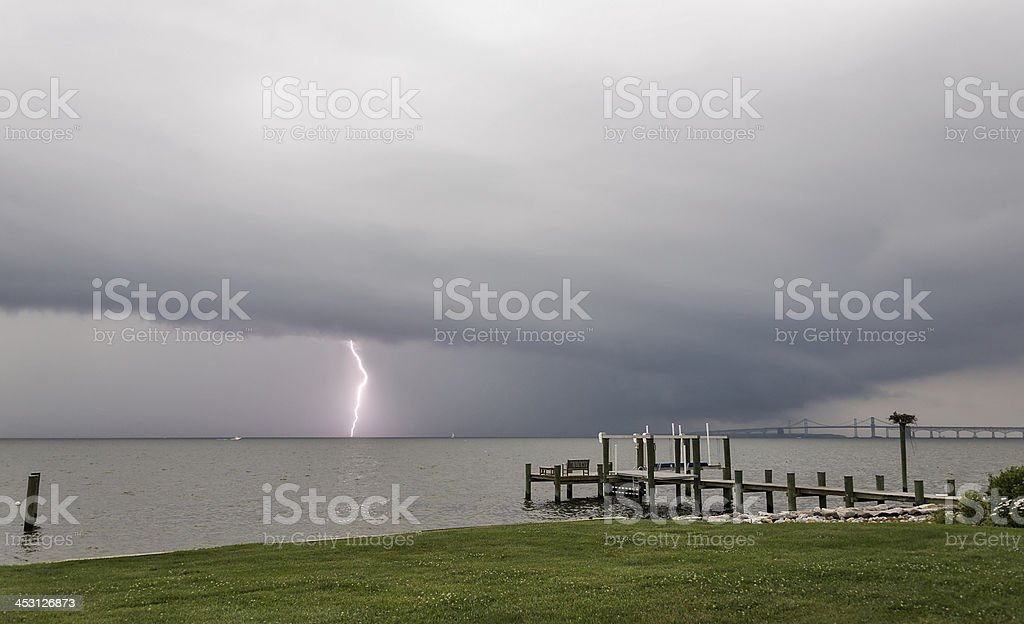 Lightening bolt pierces the Chesapeake Bay during a storm stock photo
