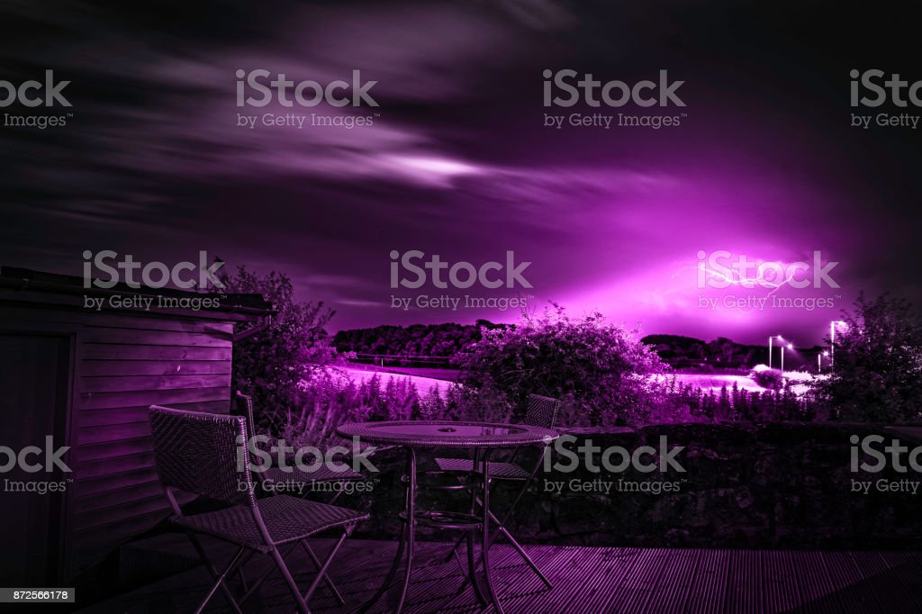 Lightening from decking seating area over gatehead field in east ayrshire Scotland, UK. stock photo
