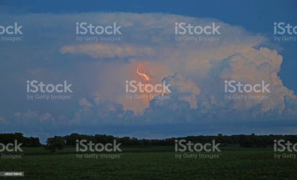 A thunder storm rumbles over a Midwestern farm, and then the...
