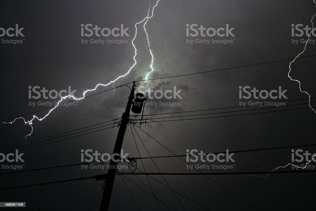 A transformer being struck by lightening.