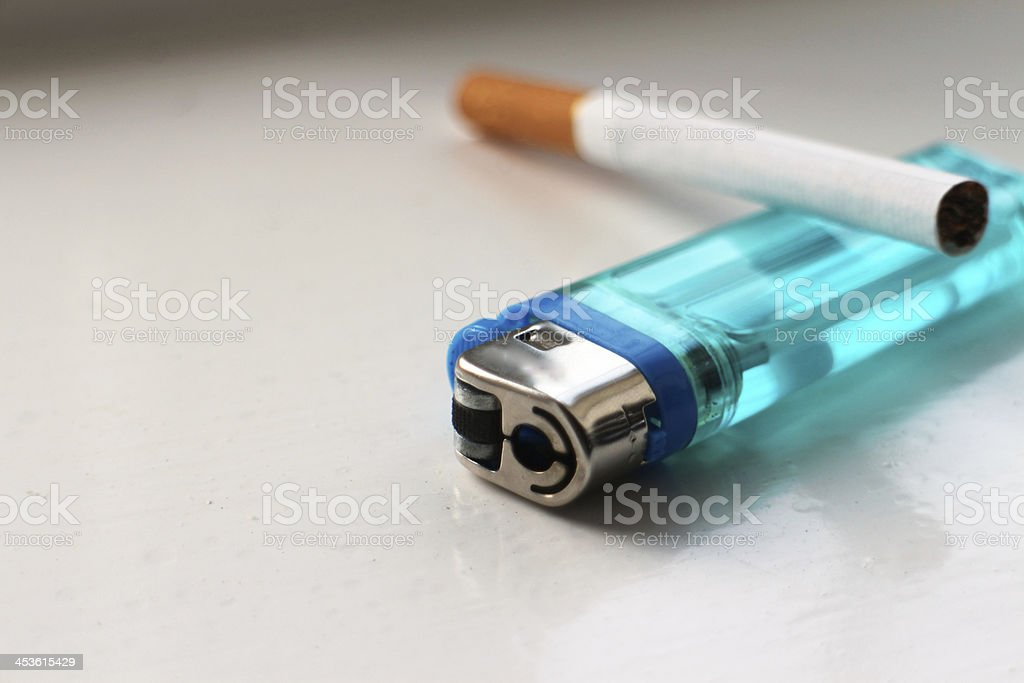 Lighter and cigarette. royalty-free stock photo