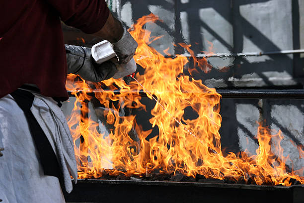 lighter fluid on barbeque stock photo