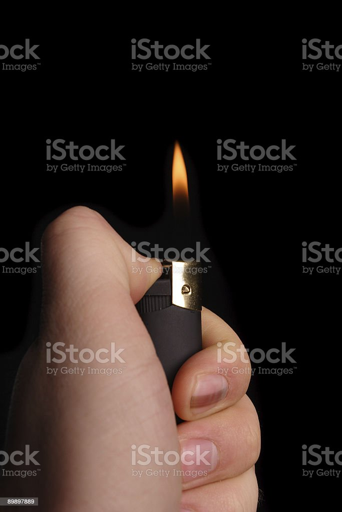 Lighter in hand royalty-free stock photo