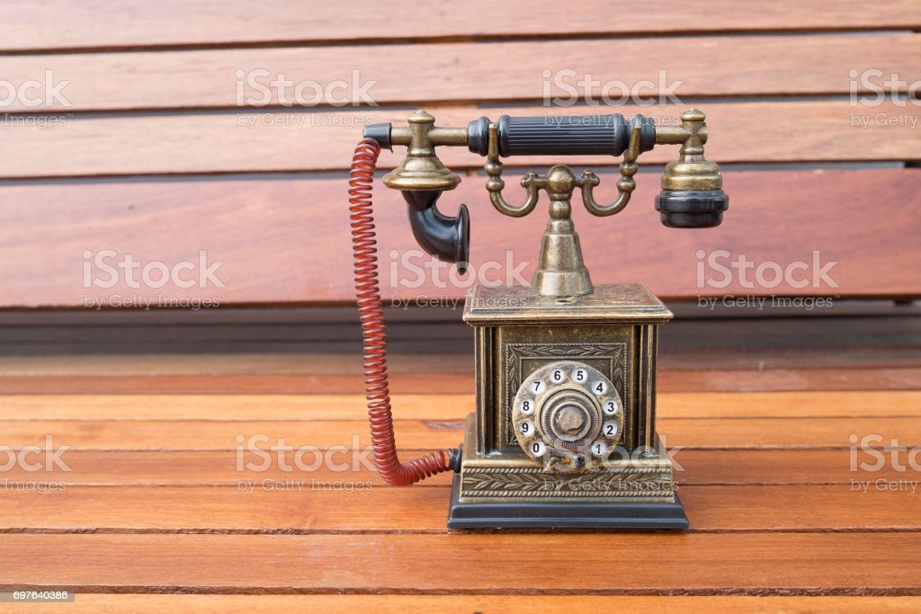 Lighter in retro classic phone model, vintage old dial Telephone on wood background stock photo