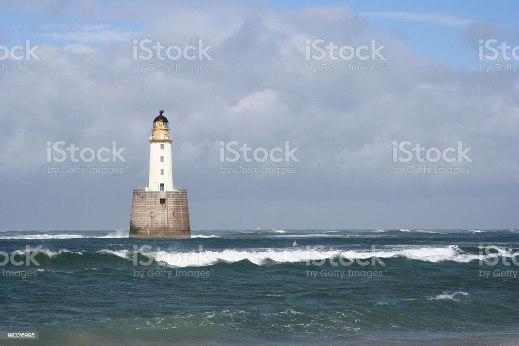 Lighthouse against cloudy sky royalty-free stock photo