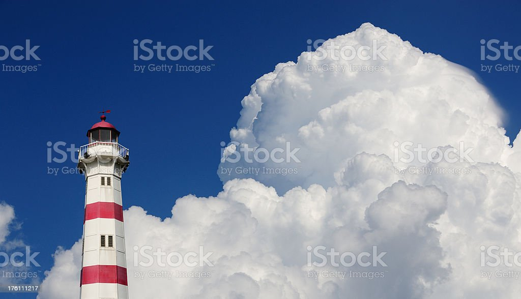 Lighthouse against dramatic sky royalty-free stock photo