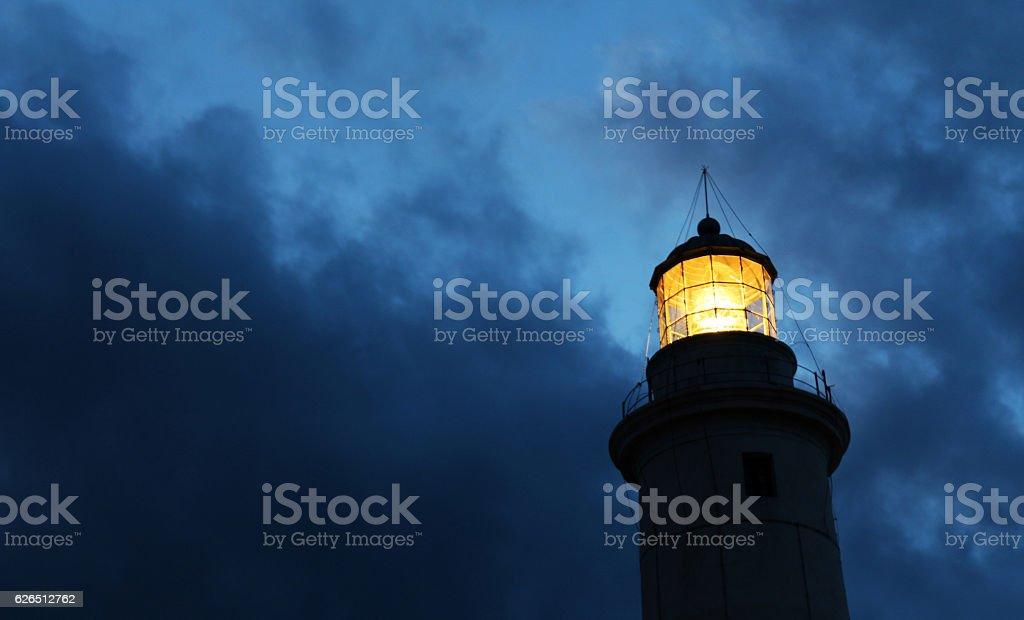 Lighthouse against evening sky stock photo