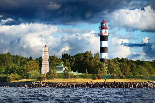 Lighthouse against stormy blue sky. Riga, Latvia