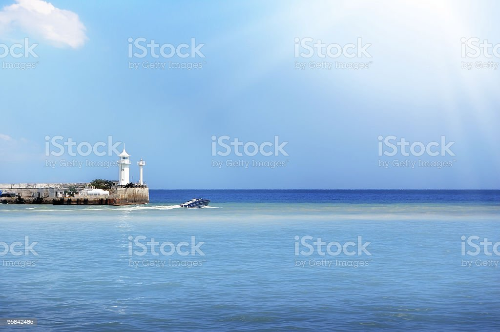 Lighthouse against the sunny sky royalty-free stock photo