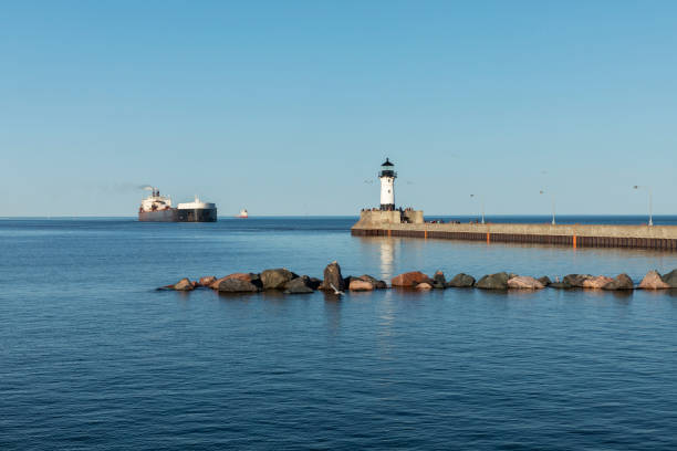A Lighthouse and A Ship On Lake Superior stock photo