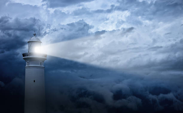 lighthouse and bad weather in background - protection stock photos and pictures