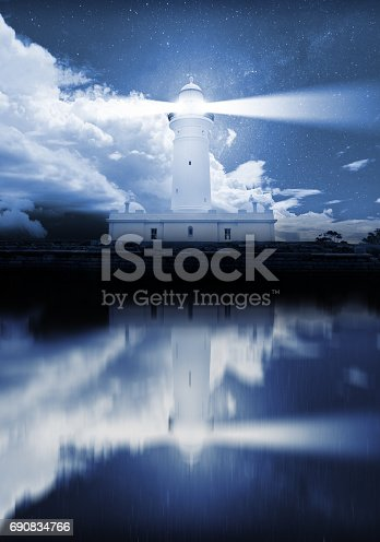 istock Lighthouse and bad weather in background, reflection in water 690834766