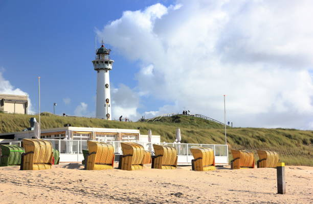 Lighthouse and Beach in Egmond aan Zee. North Sea, the Netherlands. stock photo