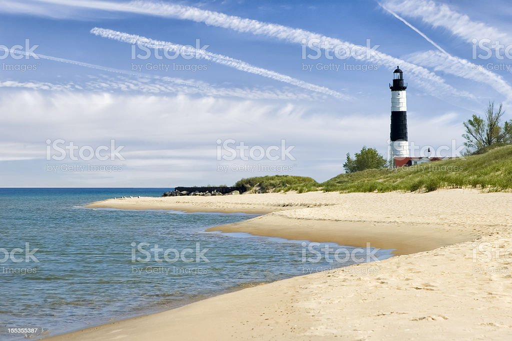 Lighthouse and Beach in Summer with Dramatic Sky Background stock photo