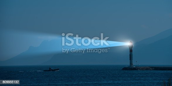 istock Lighthouse and beam at night 809955132