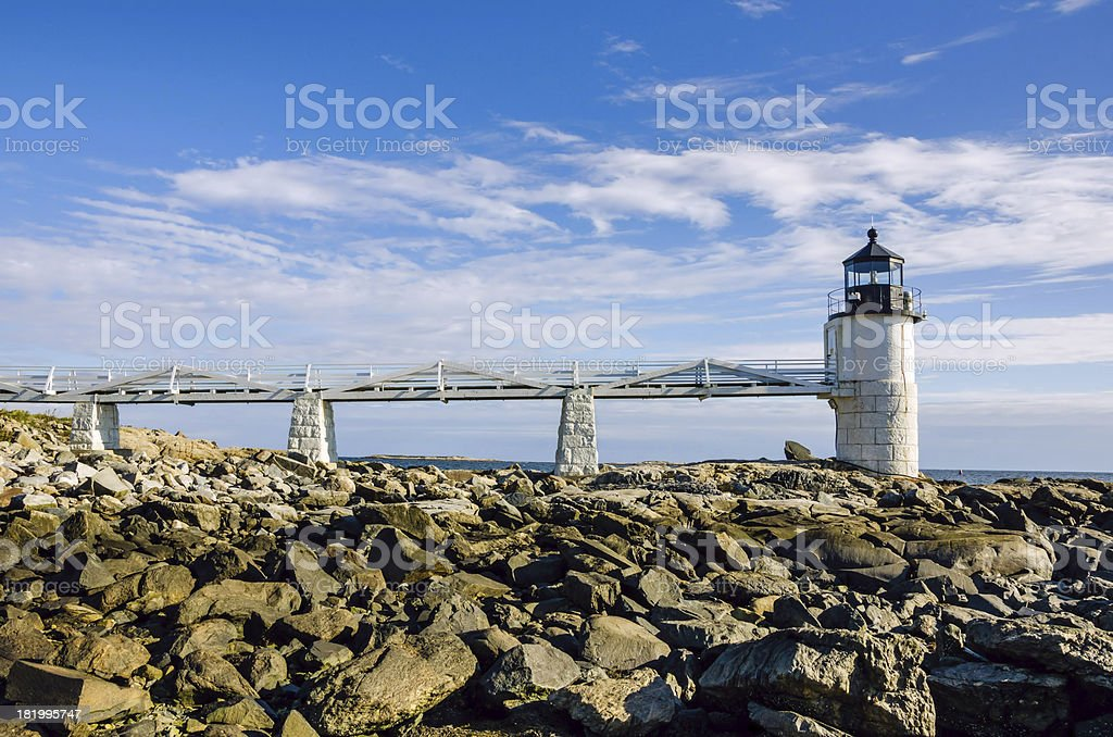 Lighthouse and Blue Sky with Clouds stock photo