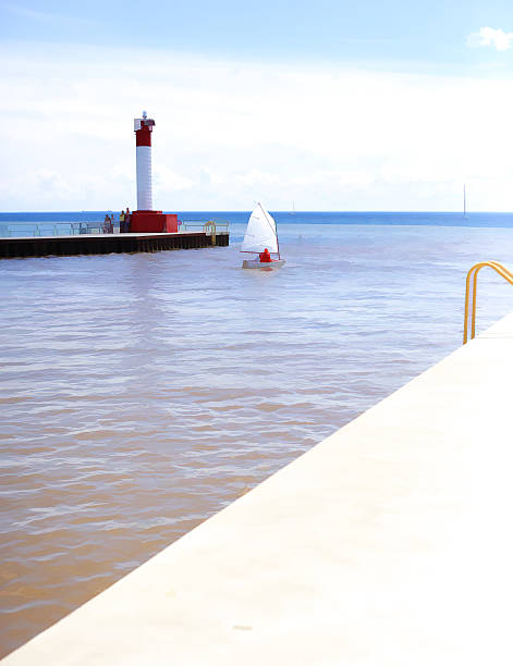 lighthouse and boat stock photo