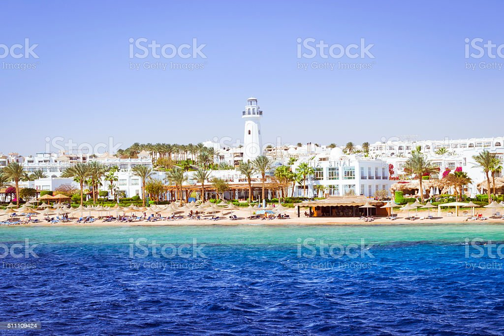 Lighthouse and hotel on the beach, Sinai, Red sea, Sharm stock photo