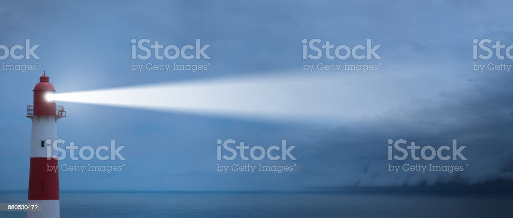 Lighthouse and incoming epic storm stock photo