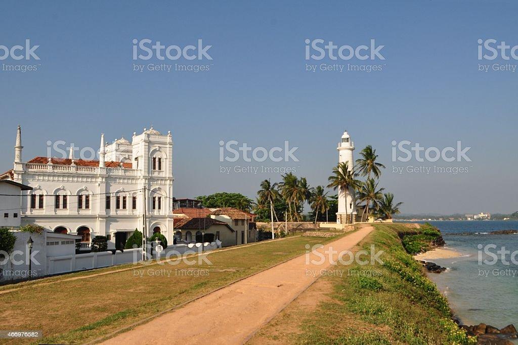 Lighthouse and Islamic school in Galle, Sri Lanka stock photo