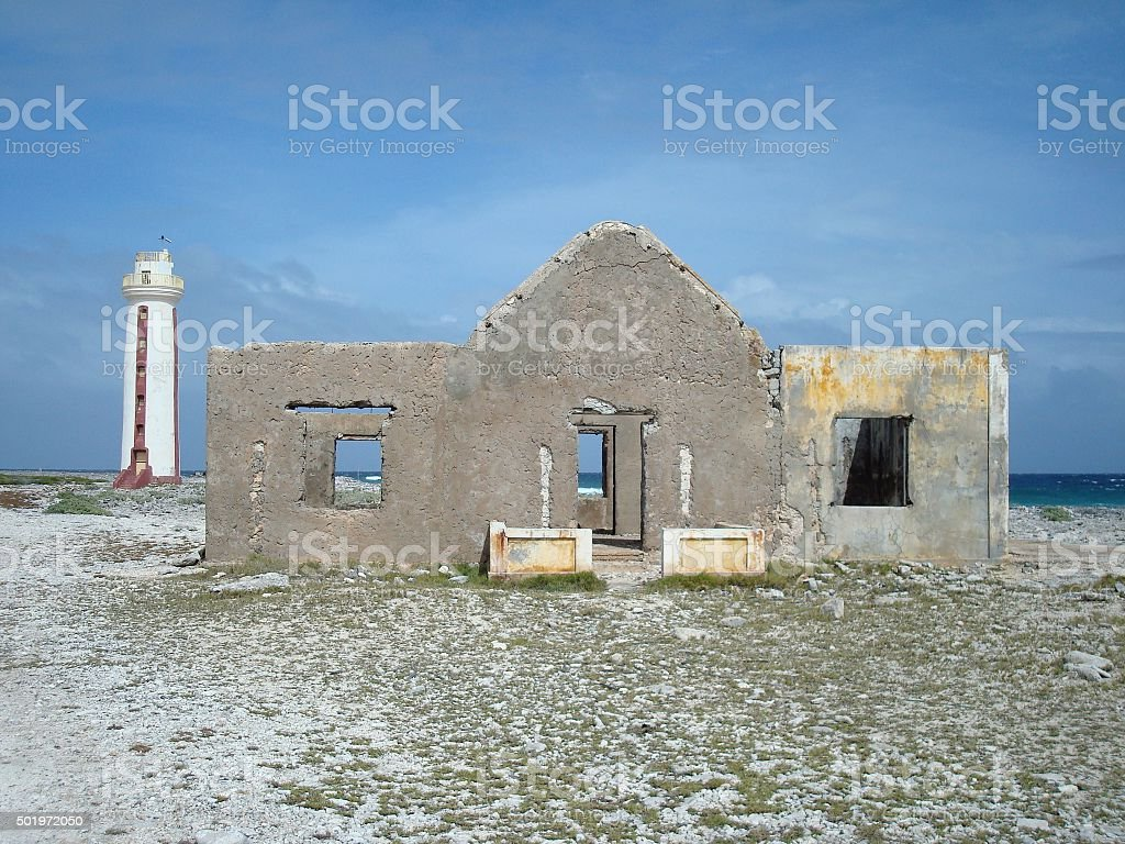 Lighthouse and keeper's house ruins stock photo