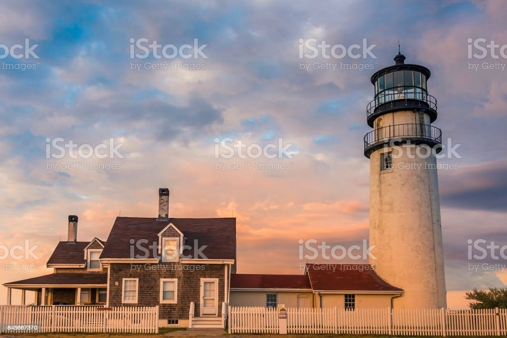 Lighthouse and keeper's house under beautiful skies stock photo
