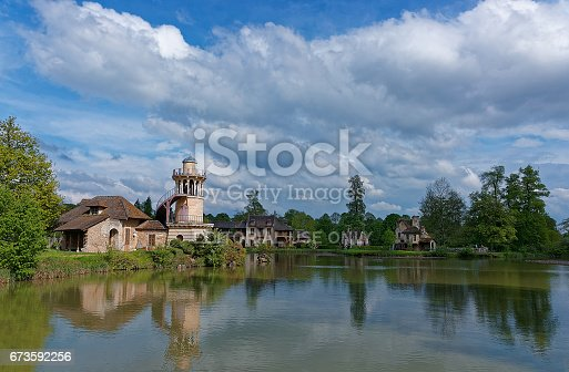 istock Lighthouse and lake in Old village of Marie Antoinette Versailles 673592256