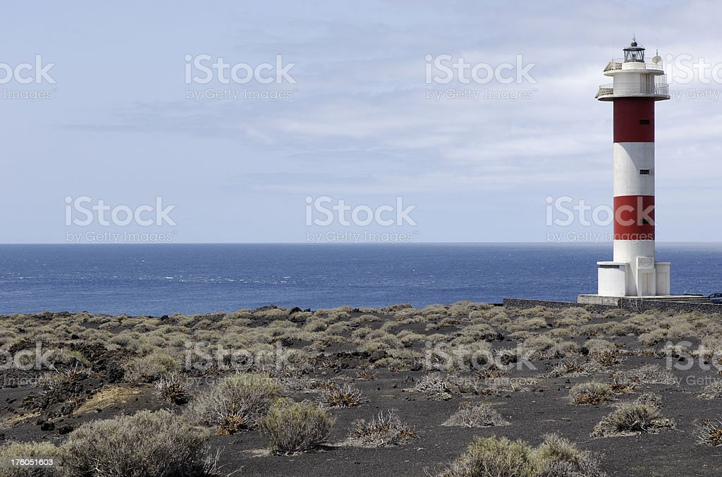 Lighthouse and lava field royalty-free stock photo