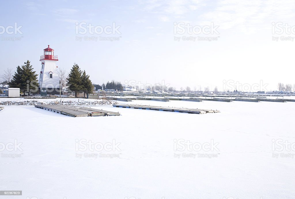 Lighthouse and Marina in the Snow royalty-free stock photo
