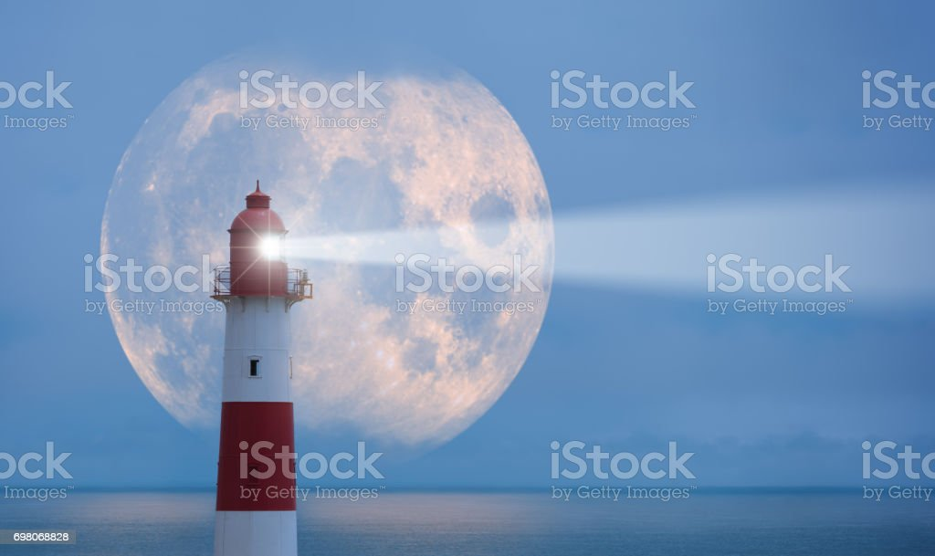 Lighthouse and moon stock photo