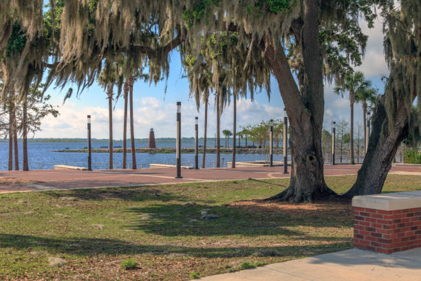 lighthouse and park view at kissimmee's lakefront park - kissimmee stock photos and pictures