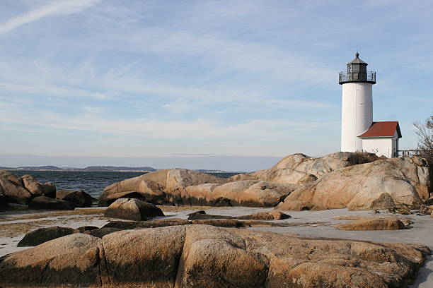 Lighthouse and Rocks lighthouse and coastal rocks gloucester massachusetts stock pictures, royalty-free photos & images