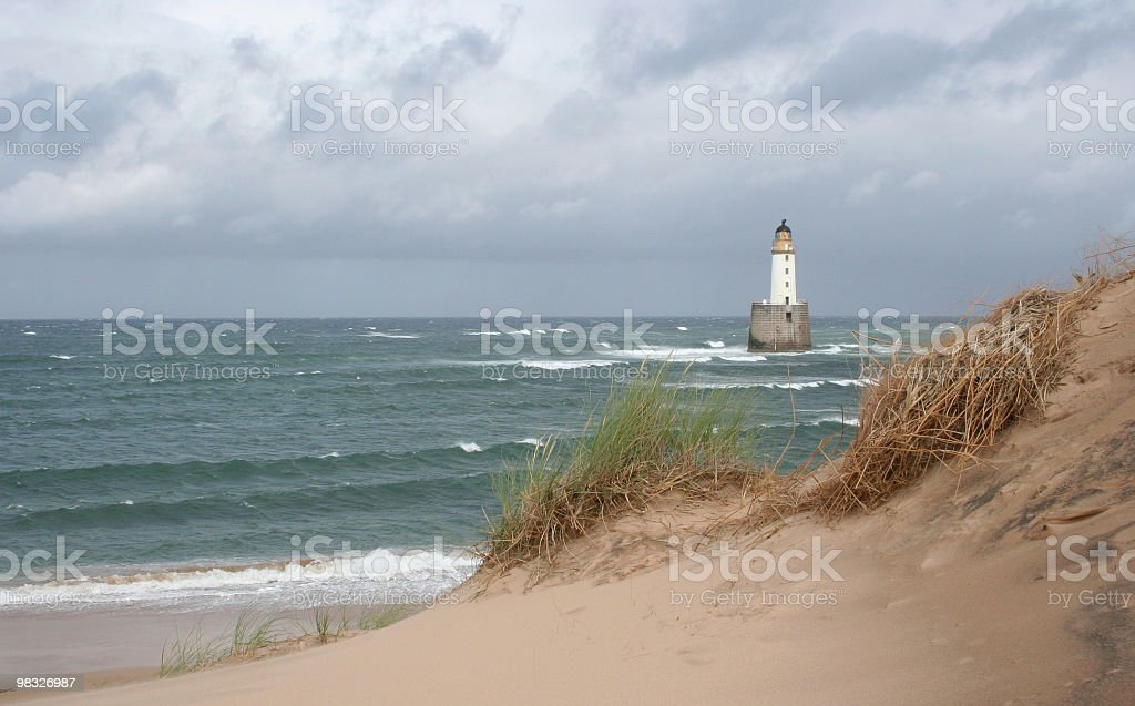 Faro e dune di sabbia su windy giorno foto stock royalty-free