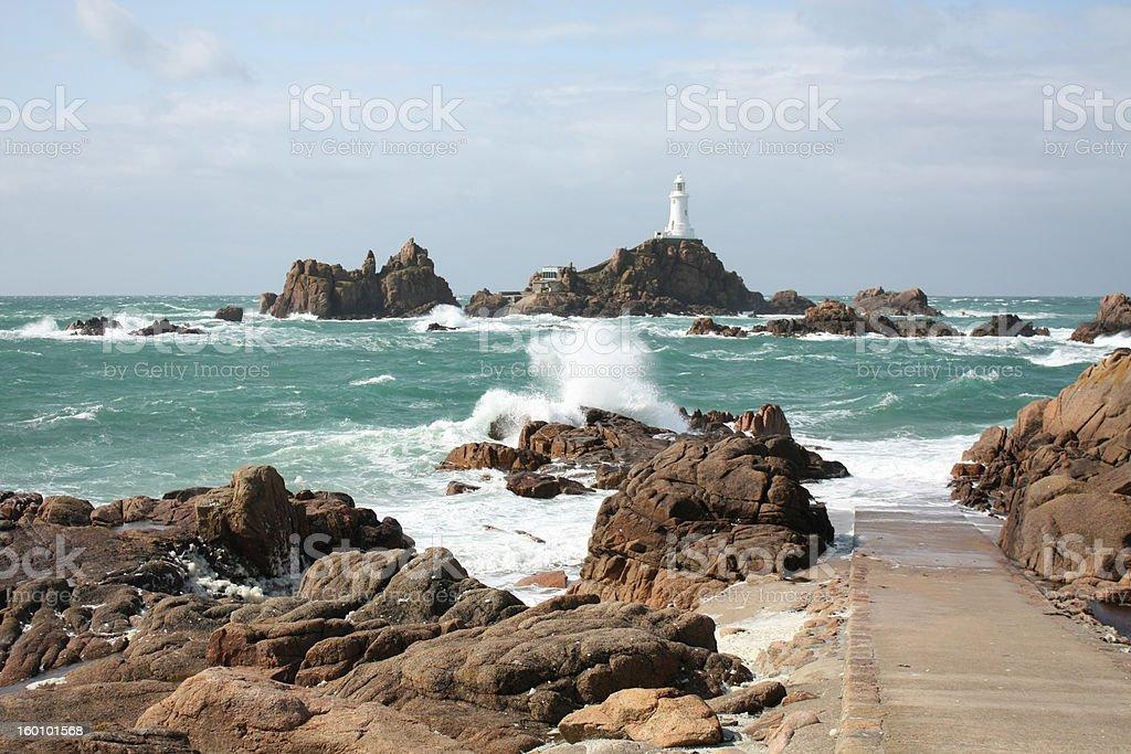 Lighthouse and sea stray stock photo