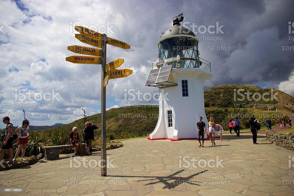 Lighthouse and signpost at Cape Reinga, Northland, New Zealand stock photo