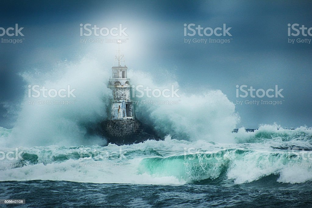 Lighthouse and storm stock photo