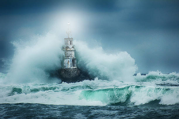 lighthouse and storm - storm stock photos and pictures