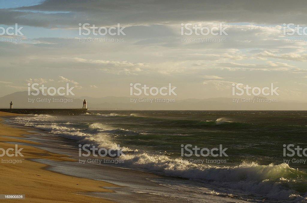 lighthouse and stormy sunset royalty-free stock photo