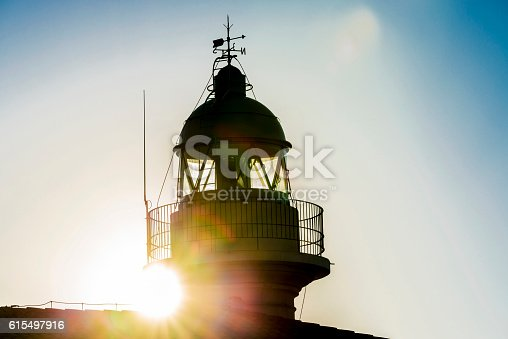 615497916 istock photo Lighthouse and sunbeams 615497916