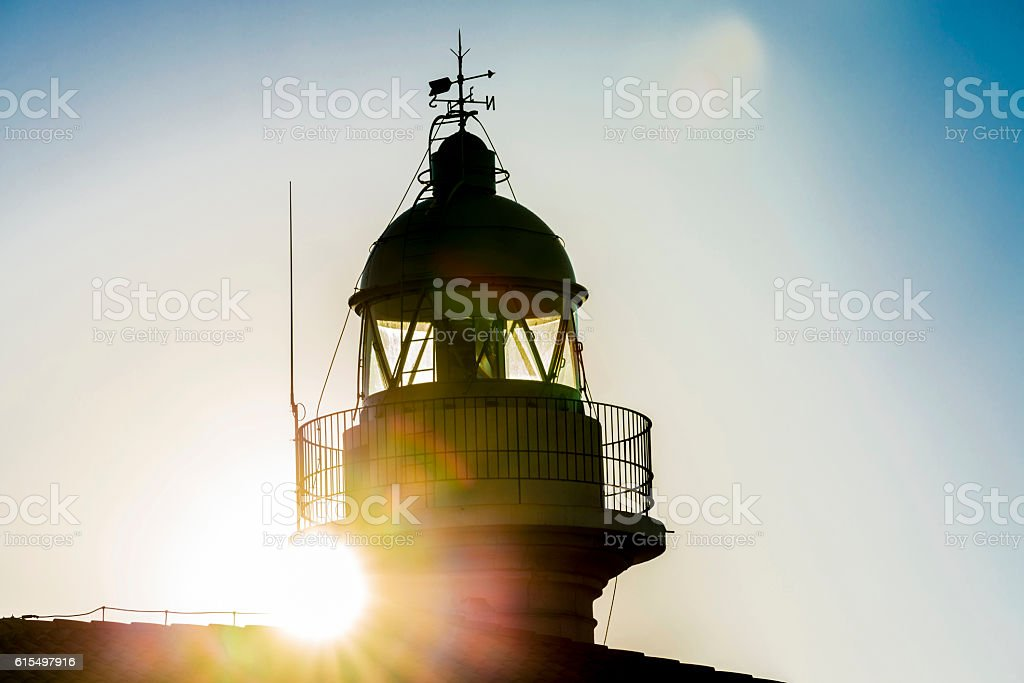 Lighthouse and sunbeams stock photo