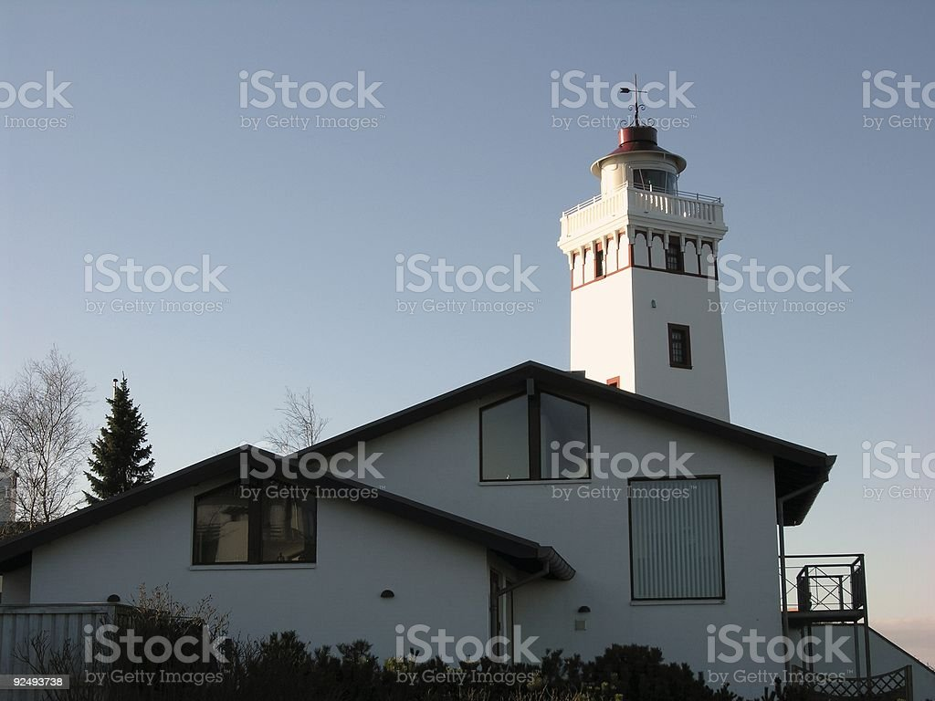 Lighthouse and villa royalty-free stock photo