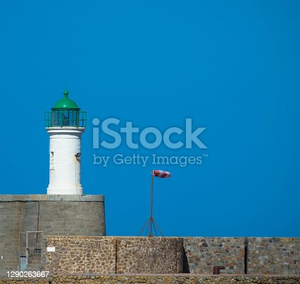 Lighthouse and weather vane against clear sky, Place for Text. Port de L′Île Rousse, Corsica