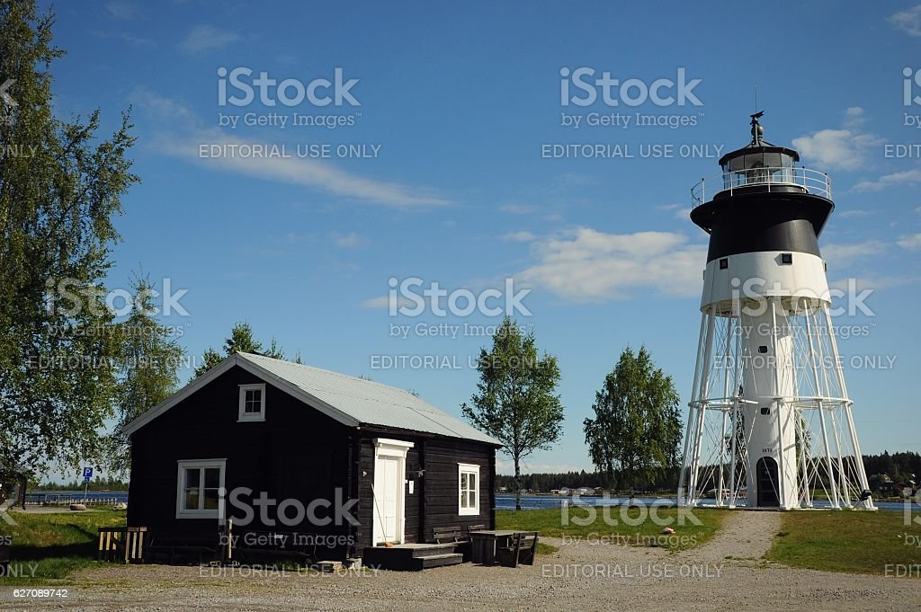 Lighthouse and wood house stock photo