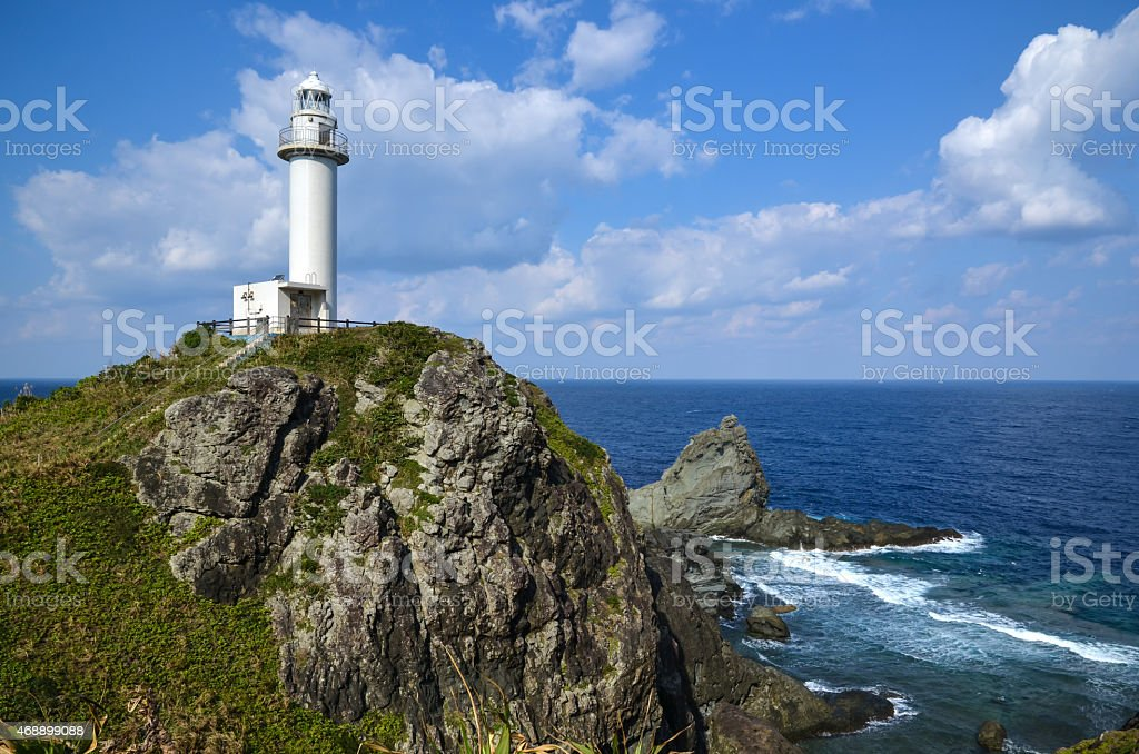 Lighthouse at cliffs in southernmost Japan stock photo