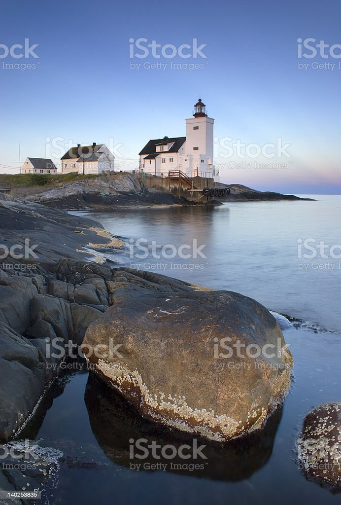 Lighthouse at dawn stock photo