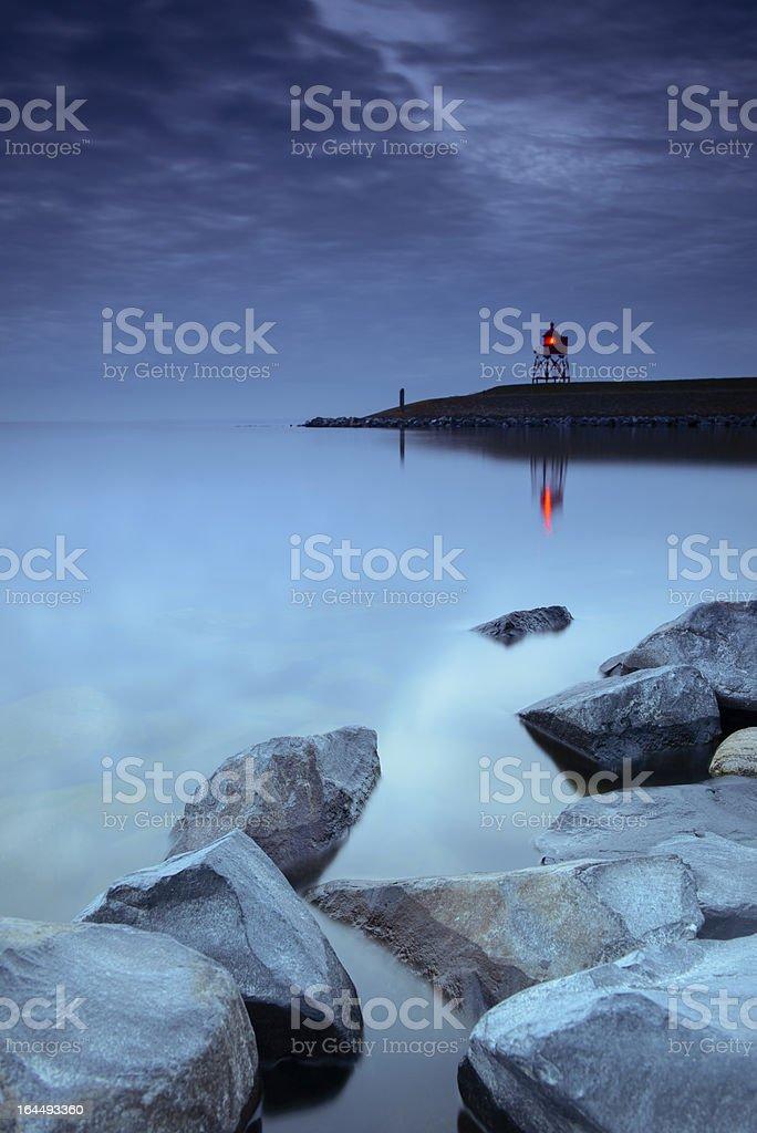 Lighthouse at dusk stock photo