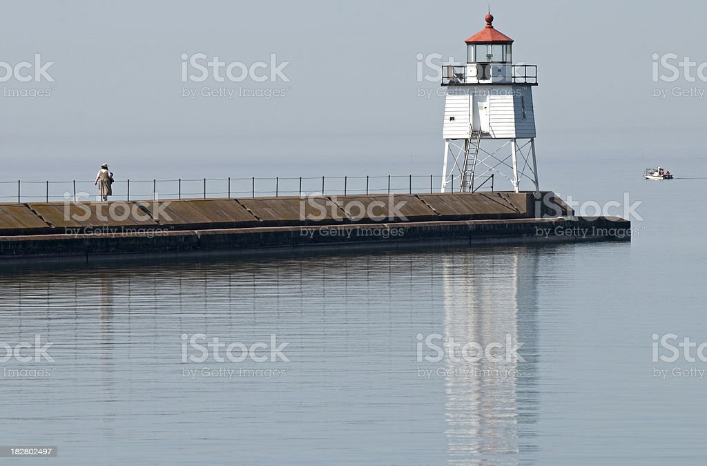 Lighthouse at end of concrete pier royalty-free stock photo